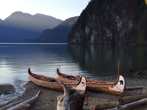 Camps Expeditions Pitt Lake canoes at dusk